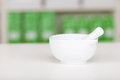 Mortar and pestle on pharmacy counter closeup of white Royalty Free Stock Image