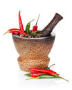 Mortar and pestle with red hot chili pepper and peppercorn isolated on white background Royalty Free Stock Photo