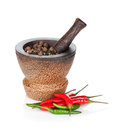 Mortar and pestle with red hot chili pepper and peppercorn isolated on white background Royalty Free Stock Photography