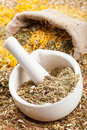 Mortar pestle and sack of healing herbs herbal medicine Royalty Free Stock Photography