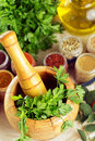 Mortar and pestle with spices on table Stock Photos