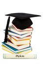 Mortarboard on books stack Stock Photos