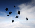 Mortarboards in the air at graduation Royalty Free Stock Photos