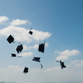 Mortarboards in the air at graduation Royalty Free Stock Images