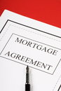 Mortgage agreement a or contract ready for signature with a fountain pen Stock Photography