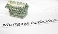 Mortgage app a application with an origami dollar house Stock Photo