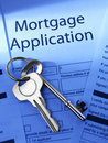 Mortgage application with house keys Stock Photos