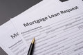 Mortgage documents with pen on gray table Stock Photo