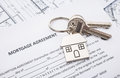Mortgage loan agreement application with house shaped keyring Stock Photo
