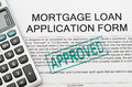 Mortgage loan application form on approved stamp Stock Photo