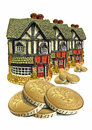 Mortgages and finances photo of three cottage homes with piles of gold coins in front of them depicting Royalty Free Stock Images