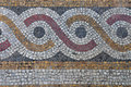 Mosaic abstract circles pattern floor background with geometric design on byzantine era church exterior Stock Photo