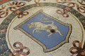 Mosaic bull in the Galleria Vittorio Emanuele in Milan Royalty Free Stock Photo