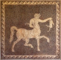 Mosaic of centaur and rabbit on wall in the archaeological museum of rhodes greece greek at fresco background photo Stock Photo