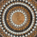 Mosaic circle floor detail of marble tile grunge background Royalty Free Stock Image