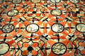 Mosaic floor in marble close up of a classic parquet with a geometric pattern Stock Image