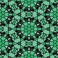 Mosaic kaleidoscope seamless pattern background - emerald green colored with black grout