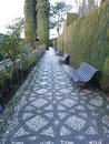Mosaic paths of the alhambra palace gardens garden are paved with patterned designed such as these pebbles are sourced from Royalty Free Stock Photography