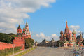 MOSCOW JULY 15: View to Kremlin Wall, Saviour Tower and St. Basil's Cathedral on Red Square on 15 July 2015 in Moscow in Russia Royalty Free Stock Photo