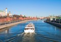 Moscow kremlin embankment of the moskva river and boat Royalty Free Stock Photos