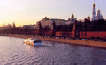Moscow kremlin and the moskva river in the evening with a pleasure boat seen from bolshoy moskvoretsky bridge february Royalty Free Stock Images