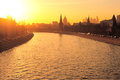 Moscow kremlin and the moskva river in evening sun seen from bolshoy moskvoretsky bridge under rays of buildings of different Royalty Free Stock Photos