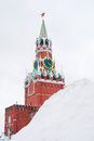 Moscow kremlin spasskaya clock tower in winter seen through the snow hill red square unesco world heritage site Stock Photography