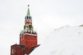 Moscow kremlin spasskaya clock tower in winter seen through the snow hill red square unesco world heritage site Stock Photo