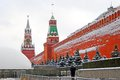 Moscow kremlin spasskaya clock tower winter view a guard policeman walks along the wall red square unesco world heritage Royalty Free Stock Photography