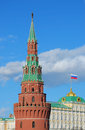 Moscow kremlin tower in a sunny winter day russian flag is waving of the roof top of the big kremlin palace on the occasion of a Royalty Free Stock Image