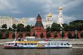 Moscow kremlin unesco world heritage site view of the a popular touristic landmark cruise ship sails on the river Stock Photos