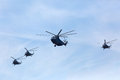 Moscow may mi and three mi helicopters fly in formation during the parade in honor of wwii victory on in russia Royalty Free Stock Images