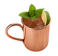 Moscow mule in a copper mug this is vodka drink served with mint and garnished with wedge of lime the image is cut out Stock Photos