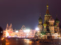 Moscow red square cathedral touristic spot in landmark view to the with saint basils by a winter night at christmas time alight by Stock Photos