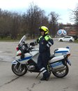 The inspector of the road police patrol on the service motorcycle controls the road. Royalty Free Stock Photo
