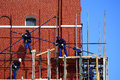 Moscow russia april workers dismantle the construction wood woods on spasskaya tower after restoration red square on Stock Photos