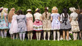 Moscow russia june dressing up girls in carnival clothes dol dolls on apple orchard kolomenskoye park Stock Photo