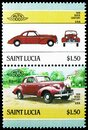 Two postage stamps printed in Saint Lucia shows 1939 Buick Century USA, Automobiles serie, circa 1986 Royalty Free Stock Photo