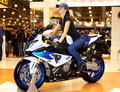 Moscow russia march th international motorcycle exhibition motopark beautiful woman bmw motorcycle posing Royalty Free Stock Photo