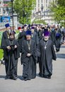 Moscow russia may orthodox priests walking along the path in kremlin s alexander garden during the commemoration of victory day Stock Photo