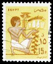 Postage stamp printed in Egypt shows Slave bearing votive fruit offering, mural, Ancient Artifacts serie, 15 Egyptian piastre, Royalty Free Stock Photo