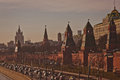 Moscow s kremlin on the sunset with street traffic near walls Royalty Free Stock Photos