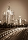 Moscow stalin skyscraper and road traffic on the embankment of the river and yauza river and road traffic in the evening Royalty Free Stock Photos