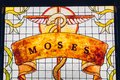 Moses painting on stained glass window. Brazen serpent on stick