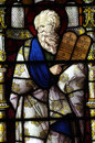 Moses with the Ten Commandments in stained glass