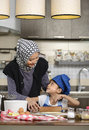 Moslem Woman Teaching Her Daughter Royalty Free Stock Photo