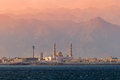 Mosque on the background of mountains at sunset. Dibba. United A Royalty Free Stock Photo