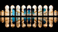 Mosque columns reflecting in the water at night Royalty Free Stock Photo