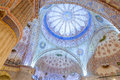 Mosque dome interior with blue ornaments Royalty Free Stock Photo