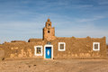 The mosque on the edge of Sahara desert in Morocco. Royalty Free Stock Photo